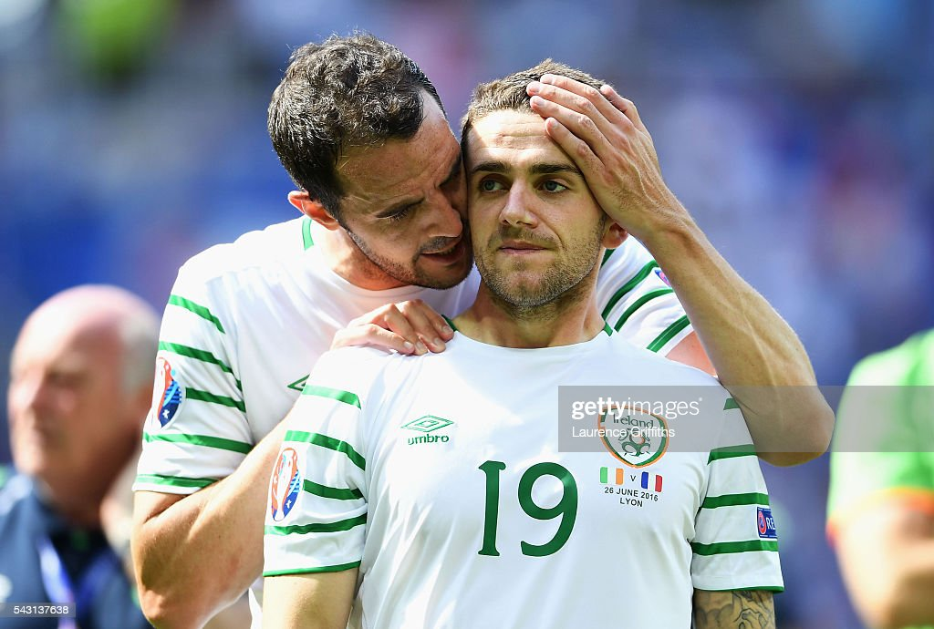 <a gi-track='captionPersonalityLinkClicked' href=/galleries/search?phrase=Robbie+Brady&family=editorial&specificpeople=9028769 ng-click='$event.stopPropagation()'>Robbie Brady</a> (R) of Republic of Ireland is consoled by <a gi-track='captionPersonalityLinkClicked' href=/galleries/search?phrase=John+O%27Shea+-+Soccer+Player&family=editorial&specificpeople=202487 ng-click='$event.stopPropagation()'>John O'Shea</a> (L) after their team's 1-2 defeat in the UEFA EURO 2016 round of 16 match between France and Republic of Ireland at Stade des Lumieres on June 26, 2016 in Lyon, France.