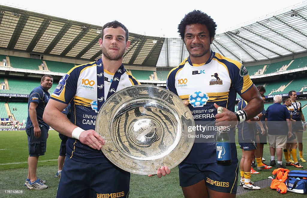 Robbie Coleman, (L) captain of the ACT Brumbies and Henry Speight match winning try scorer, lift the World Club 7's Cup after defeating Auckland in the final during the World Club Cup 7's at Twickenham Stadium on August 18, 2013 in London, England.