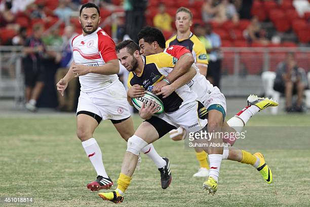 Robbie Coleman of The Brumbies charges forward during the World Club 10s match between The Brumbies and Biarritz Olympique at the National Stadium at...