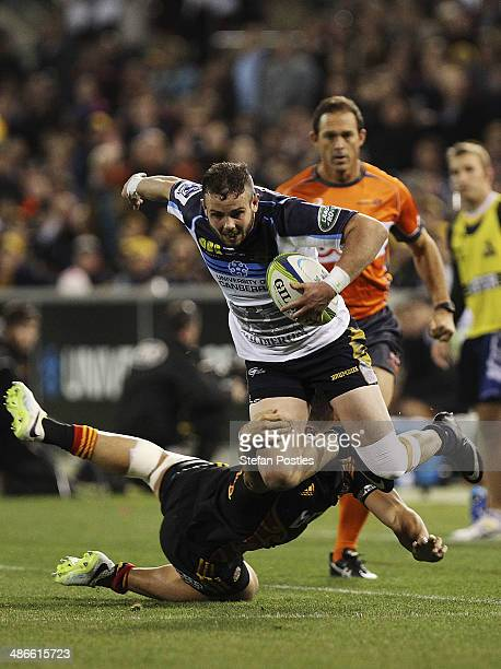 Robbie Coleman of the Brumbies is tackled during the round 11 Super Rugby match between the Brumbies and the Chiefs at Canberra Stadium on April 25...
