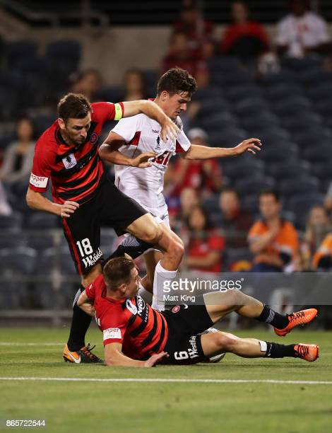 Robbie Cornthwaite and Jacob Melling of the Wanderers defend on George Blackwood of United during the FFA Cup Semi Final match between the Western...