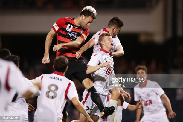 Robbie Cornthwaite of the Wanderers heads the ball next to Jordan Elsey of United during the FFA Cup Semi Final match between the Western Sydney...