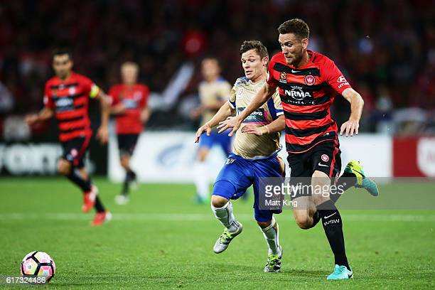 Robbie Cornthwaite of the Wanderers is challenged by Wayne Brown of the Jets during the round three ALeague match between the Western Sydney...