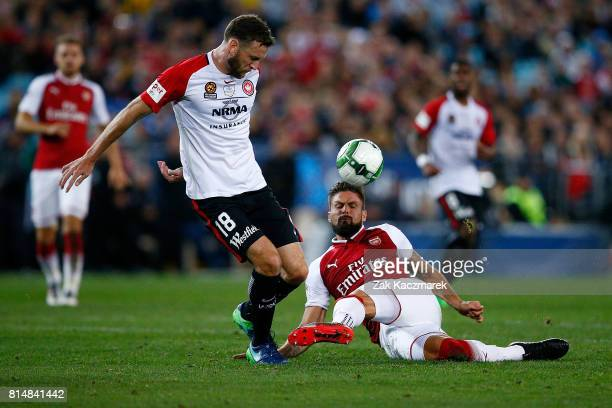 Robbie Cornthwaite of the Wanderers is tackled by Olivier Giroud of Arsenal during the match between the Western Sydney Wanderers and Arsenal FC at...