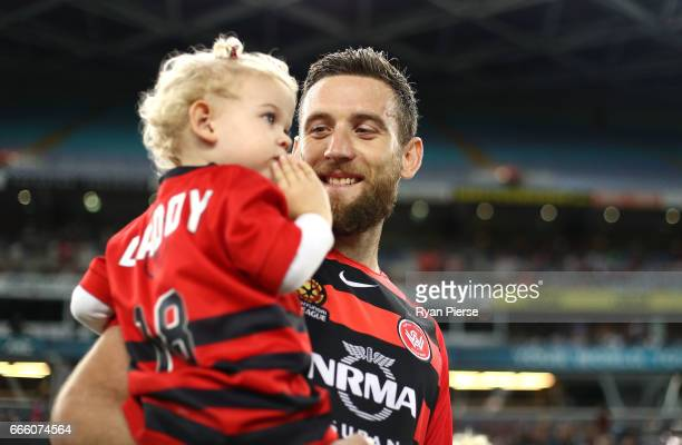 Robbie Cornthwaite of the Wanderers walks out with his daughter during the round 26 ALeague match between the Western Sydney Wanderers and the...