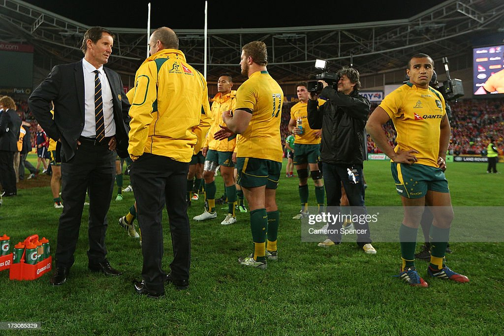 <a gi-track='captionPersonalityLinkClicked' href=/galleries/search?phrase=Robbie+Deans&family=editorial&specificpeople=606884 ng-click='$event.stopPropagation()'>Robbie Deans</a>, coach of the Wallabies and <a gi-track='captionPersonalityLinkClicked' href=/galleries/search?phrase=Will+Genia&family=editorial&specificpeople=4110822 ng-click='$event.stopPropagation()'>Will Genia</a> after losing the International Test match between the Australian Wallabies and British & Irish Lions at ANZ Stadium on July 6, 2013 in Sydney, Australia.