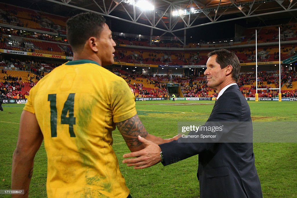 Robbie Deans, coach of the Wallabies shakes hands with Israel Folau of the Wallabies after losing the First Test match between the Australian Wallabies and the British & Irish Lions at Suncorp Stadium on June 22, 2013 in Brisbane, Australia.
