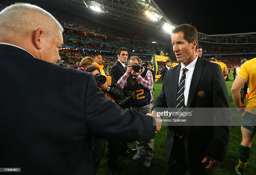 Robbie Deans, coach of the Wallabies shakes hands with Warren Gatland, coach of the Lions after losing the International Test match between the Australian Wallabies and British & Irish Lions at ANZ Stadium on July 6, 2013 in Sydney, Australia.
