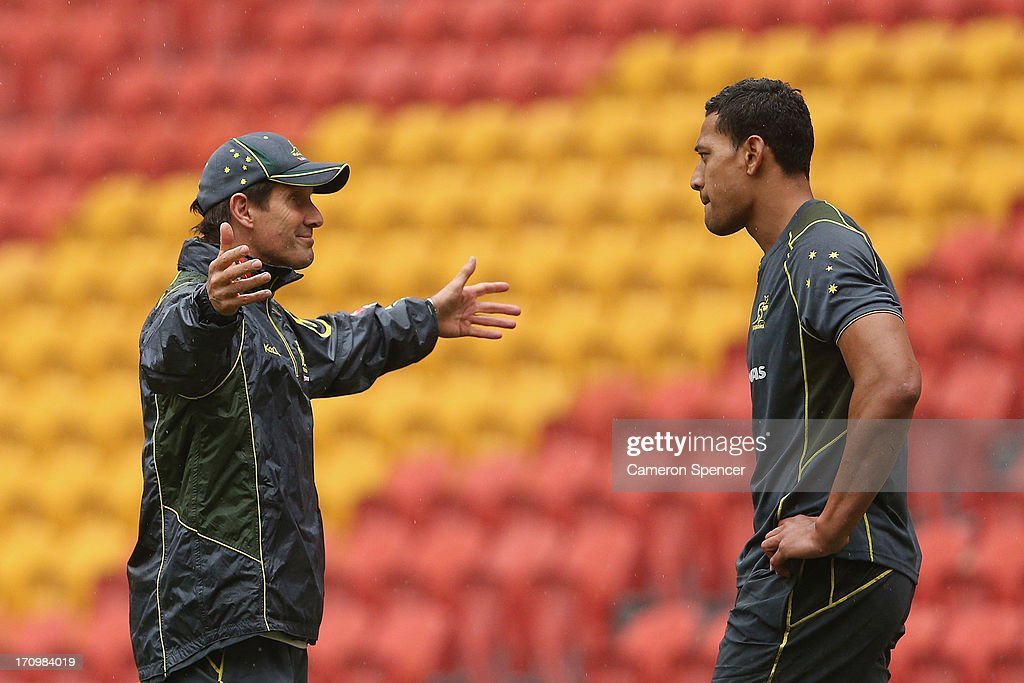 <a gi-track='captionPersonalityLinkClicked' href=/galleries/search?phrase=Robbie+Deans&family=editorial&specificpeople=606884 ng-click='$event.stopPropagation()'>Robbie Deans</a>, coach of the Wallabies talks to <a gi-track='captionPersonalityLinkClicked' href=/galleries/search?phrase=Israel+Folau&family=editorial&specificpeople=4194699 ng-click='$event.stopPropagation()'>Israel Folau</a> of the Wallabies during an Australian Wallabies Captain's Run at Suncorp Stadium on June 21, 2013 in Brisbane, Australia.