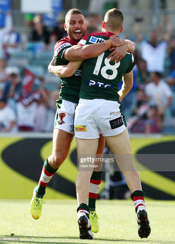 Robbie Farah and Adam Doueihi of Lebanon celebrate a try by Doueihi during the 2017 Rugby League World Cup match between France and Lebanon at Canberra Stadium on October 29, 2017 in Canberra, Australia.
