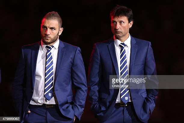 Robbie Farah and Blues Coach Laurie Daley look on after losing game three of the State of Origin series between the Queensland Maroons and the New...