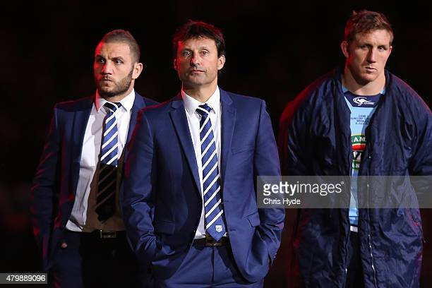 Robbie Farah Blues Coach Laurie Daley and Ryan Hoffman look on after losing game three of the State of Origin series between the Queensland Maroons...