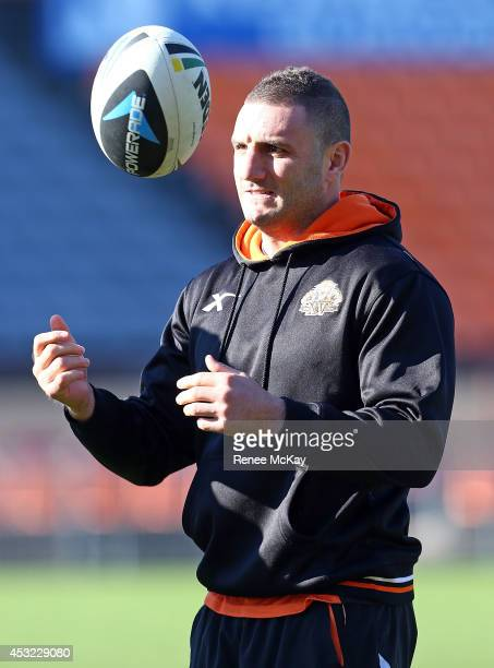 Robbie Farah catches the ball during a Wests Tigers NRL training session at Concord Oval on August 6 2014 in Sydney Australia