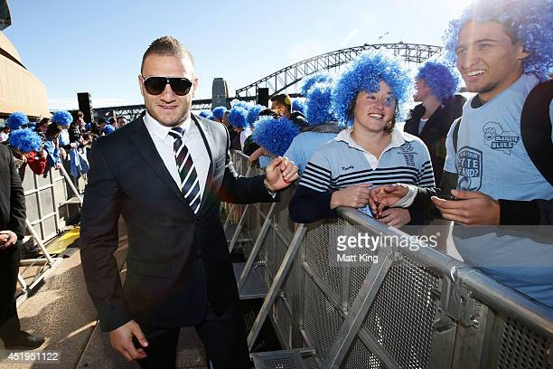 Robbie Farah celebrates with fans during the NSW Blues State of Origin series victory celebrations at Sydney Opera House on July 10 2014 in Sydney...
