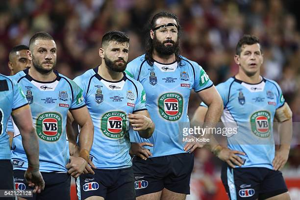 Robbie Farah Josh Mansour Aaron Woods and Greg Bird of the Blues looks dejected after a try during game two of the State Of Origin series between the...