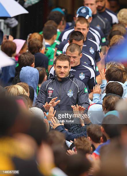 Robbie Farah leads the Blues on the field through a guard of honour made up of junior rugby league players during a New South Wales Origin training...