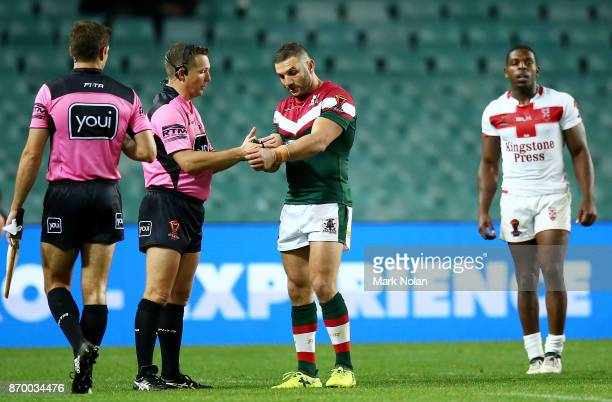 Robbie Farah of Lebanon makes an official complaint of biting against Jermaine McGillvary of England during the 2017 Rugby League World Cup match...