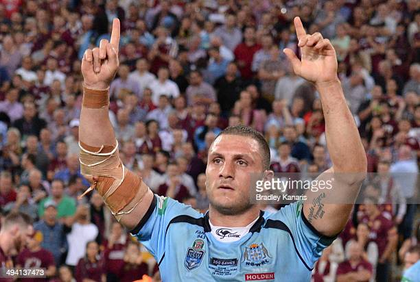 Robbie Farah of the Blues celebrates victory after game one of the State of Origin series between the Queensland Maroons and the New South Wales...