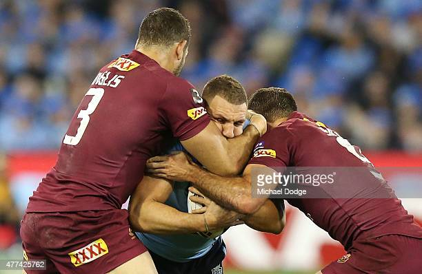 Robbie Farah of the Blues is tackled by Greg Inglis of the Maroons and Cameron Smith during game two of the State of Origin series between the New...
