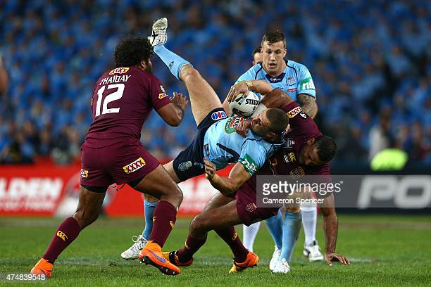 Robbie Farah of the Blues is tackled during game one of the State of Origin series between the New South Wales Blues and the Queensland Maroons at...