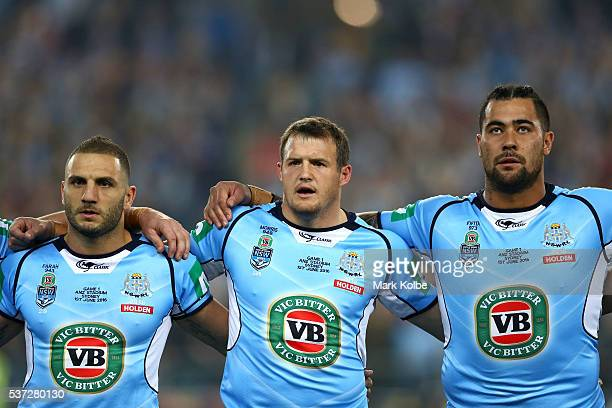 Robbie Farah of the Blues Josh Morris of the Blues and Andrew Fifita of the Blues sing the national anthem before game one of the State Of Origin...