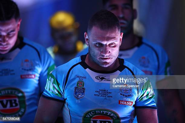 Robbie Farah of the Blues leads the team onto the field for the second half during game three of the State Of Origin series between the New South...