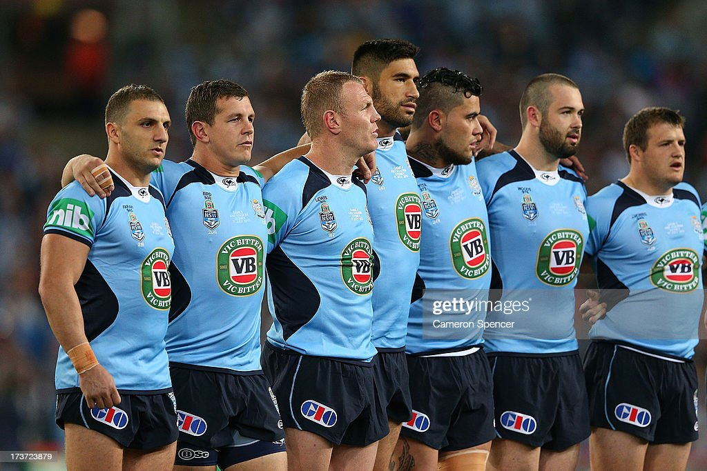 Robbie Farah (L) of the Blues sing the national anthem before game three of the ARL State of Origin series between the New South Wales Blues and the Queensland Maroons at ANZ Stadium on July 17, 2013 in Sydney, Australia.