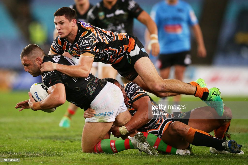 Robbie Farah of the Rabbitohs is tackled by Mitchell Moses of the Tigers during the round ten NRL match between the Wests Tigers and the South Sydney Rabbitohs at ANZ Stadium on May 12, 2017 in Sydney, Australia.