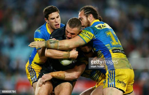 Robbie Farah of the Rabbitohs is tackled during the round 12 NRL match between the South Sydney Rabbitohs and the Parramatta Eels at ANZ Stadium on...