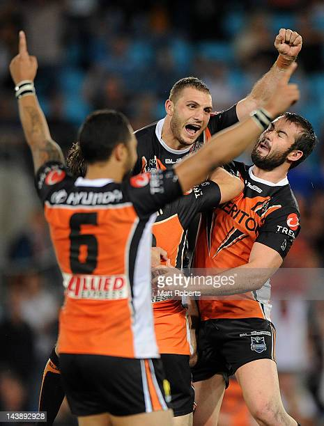 Robbie Farah of the Tigers celebrates kicking the winning field goal during the round nine NRL match between the Gold Coast Titans and the Wests...
