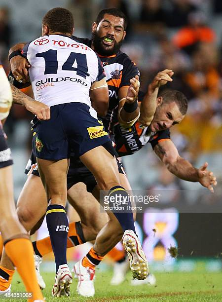 Robbie Farah of the Tigers dislocates his elbow in an attempted tackle on Ray Thompson of the Cowboys during the round 6 NRL match between the Wests...