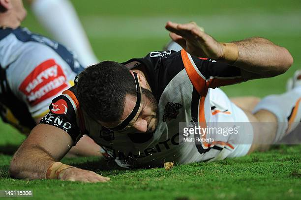 Robbie Farah of the Tigers reacts during the round 20 NRL match between the North Queensland Cowboys and the Wests Tigers at Dairy Farmers Stadium on...