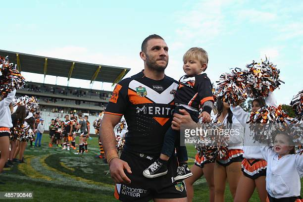 Robbie Farah of the Wests Tigers leaves the field after the Tigers last home game of the season during the round 25 NRL match between the Wests...