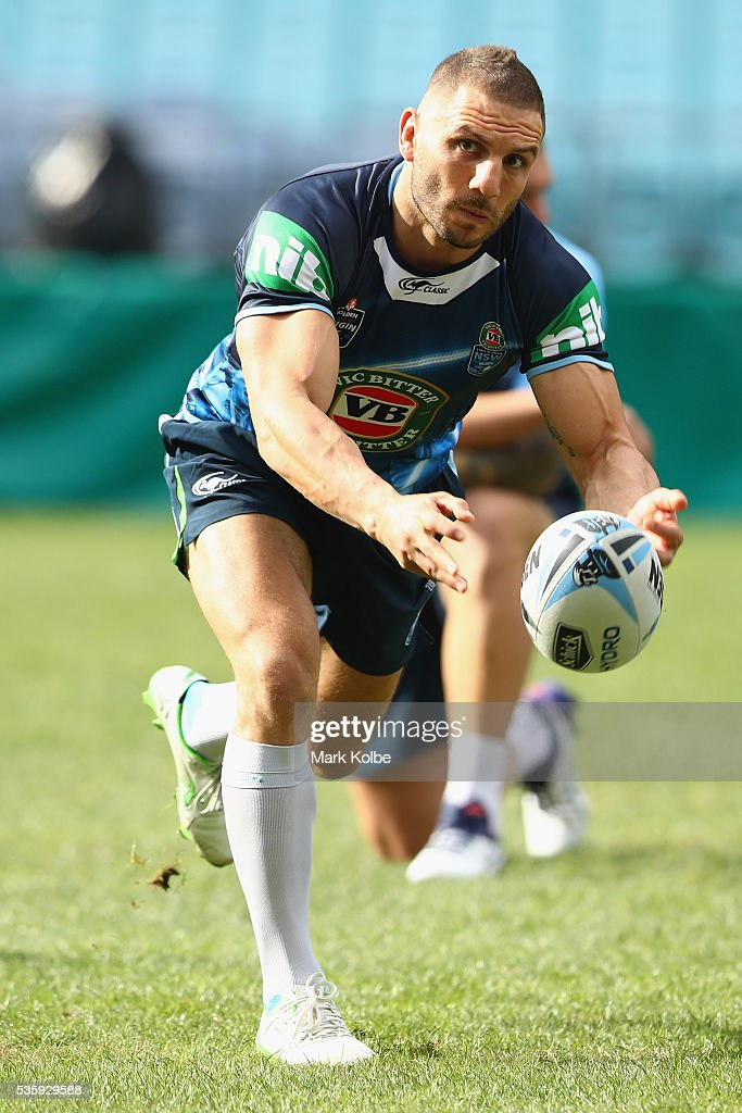 <a gi-track='captionPersonalityLinkClicked' href=/galleries/search?phrase=Robbie+Farah&family=editorial&specificpeople=544364 ng-click='$event.stopPropagation()'>Robbie Farah</a> passes during the New South Wales State of Origin captain's run at ANZ Stadium on May 31, 2016 in Sydney, Australia.