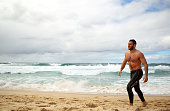 Robbie Farah walks out of the surf during a Wests Tigers NRL recovery session at Coogee Beach on August 22 2011 in Sydney Australia