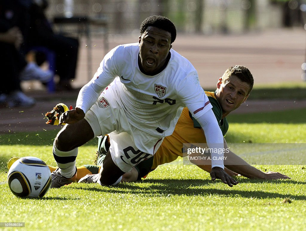Robbie Findley (R) of the US and Australia's Jason Culina fall on the ground during a friendly football match at Ruimsig Stadium in Roodepoort, Johannesburg on June 5, 2010, prior to the FIFA 2010 world cup.