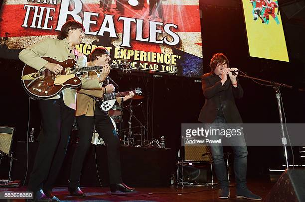 Robbie Fowler ambassador of Liverpool sings with The Beatles cover band during a visit to a supporters club on July 26 2016 in Los Angeles California