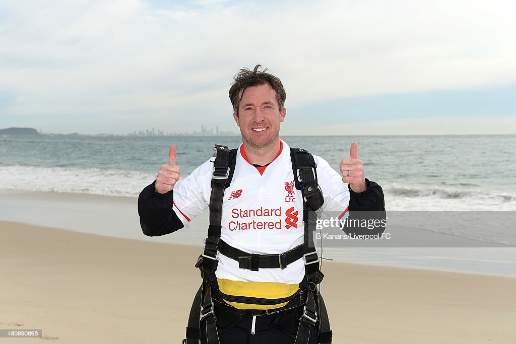 <a gi-track='captionPersonalityLinkClicked' href=/galleries/search?phrase=Robbie+Fowler&family=editorial&specificpeople=206154 ng-click='$event.stopPropagation()'>Robbie Fowler</a> holds up the new Liverpool away jersey after sky diving onto Kirra Beach on July 16, 2015 at the Gold Coast, Australia.