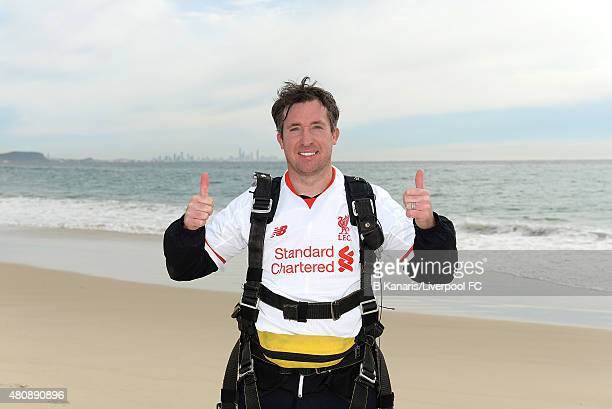 Robbie Fowler holds up the new Liverpool away jersey after sky diving onto Kirra Beach on July 16 2015 at the Gold Coast Australia
