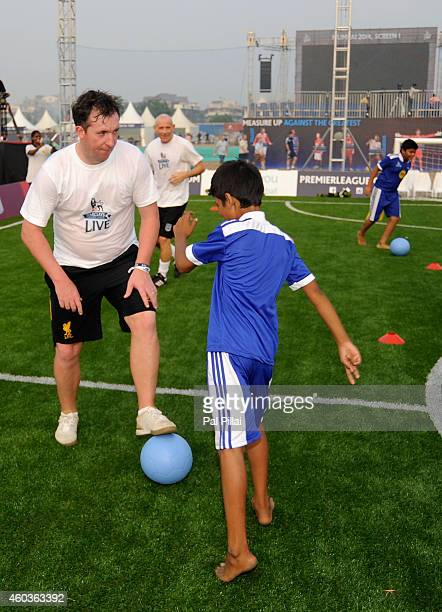 Robbie Fowler Liverpool legend plays with the kids from Magic bus during the Barclays Premier League 'Live' event on December 12 2014 in Mumbai India