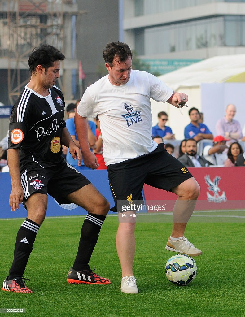 Robbie Fowler, Liverpool legend tackes Dino Morea, Bollywood actor during an exhibition match played between BPL legends and All star FC from Bollywood during the Barclays Premier League 'Live' event on December 12, 2014 in Mumbai, India.