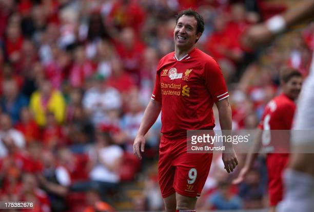 Robbie Fowler of Liverpool in good spirits after a near miss provided by Steven Gerrard during the Steven Gerrard Testimonial Match between Liverpool...