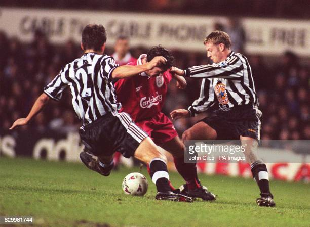 Robbie Fowler of Liverpool is sandwiched between David Batty and Philippe Albert of Newcastle in their Coca Cola Quarter Final clash at St James's...