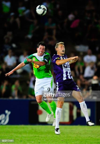 Robbie Fowler of the Fury and Jamie Coyne of the Gory compete for the ball during the round 12 ALeague match between the North Queensland Fury and...
