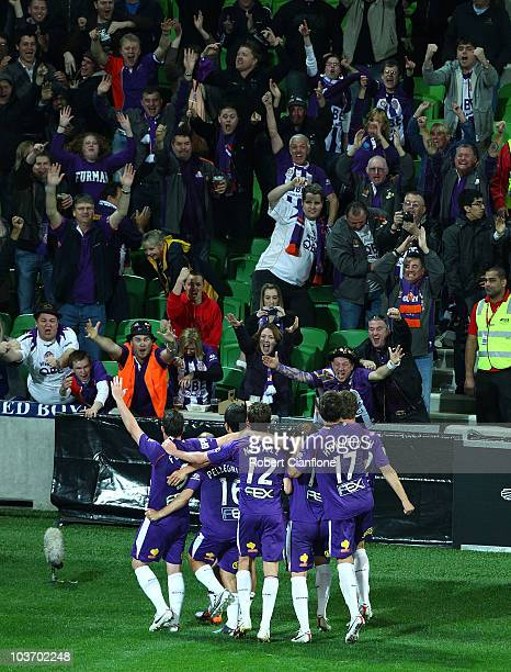 Robbie Fowler of the Glory celebrates scoring his penalty with team mates during the round four ALeague match between the Melbourne Heart and the...
