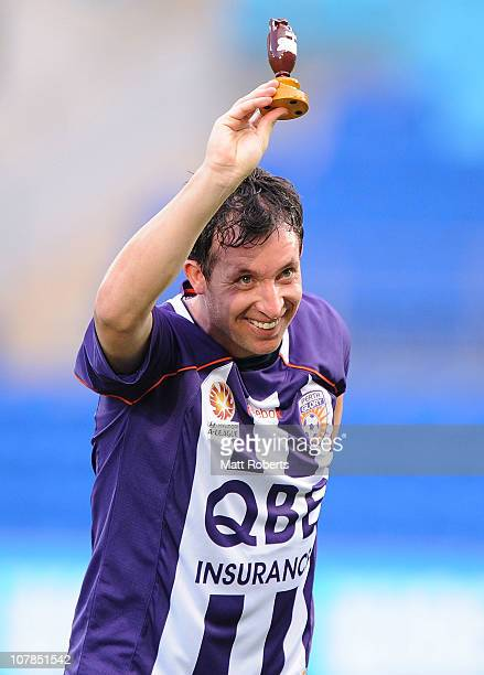 Robbie Fowler of the Glory holds up an ashes replica urn before the round 21 ALeague match between Gold Coast United and the Perth Glory at Skilled...