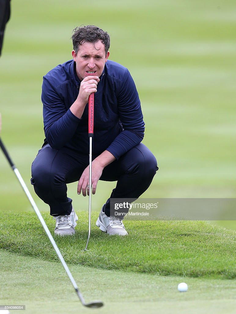 Robbie Fowler plays a hole during the BMW PGA Celebrity Pro-Am Golf Championship at Wentworth on May 25, 2016 in Virginia Water, England.