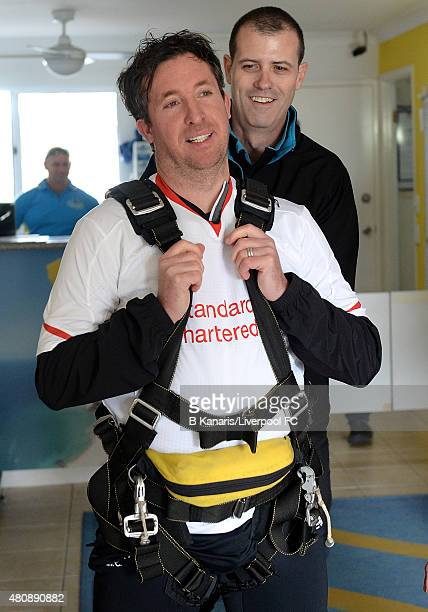 Robbie Fowler prepares to sky dive onto Kirra Beach in the new Liverpool away jersey on July 16 2015 at the Gold Coast Australia