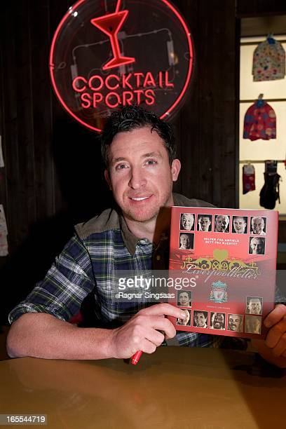 Robbie Fowler signs the book Liverpool FC Heroes at the Moods of Norway store on April 4 2013 in Oslo Norway
