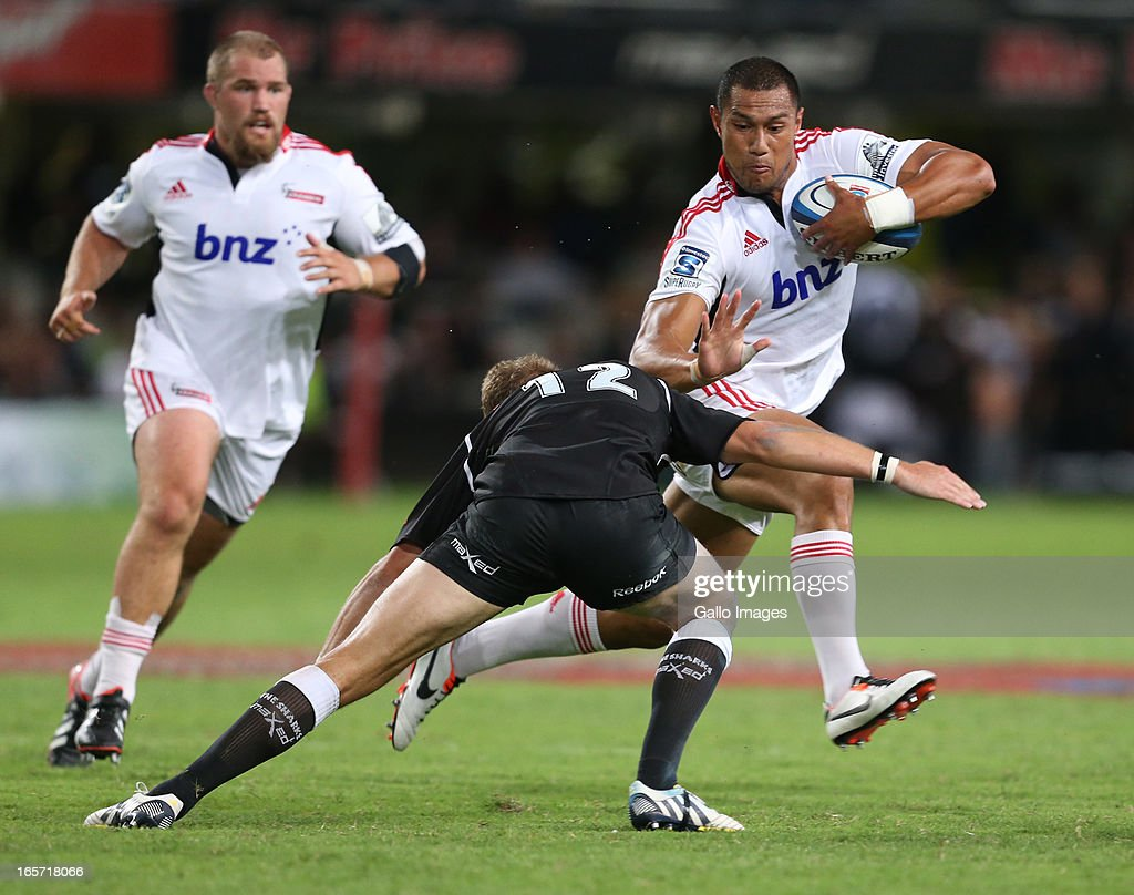 Robbie Fruean of Crusaders (R) is challenged during the Super Rugby round eight match between the Sharks and Crusaders from Kings Park on April 05, 2013 in Durban, South Africa.